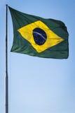El agitar de la bandera del Brasil Imagen de archivo libre de regalías