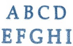 El agua de la carta cae alfabeto Imagenes de archivo