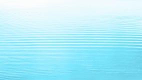 El agua ondula el fondo Foto de archivo libre de regalías