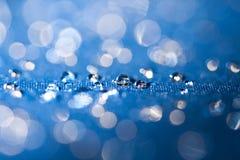 El agua potable cae macro Imagen de archivo libre de regalías