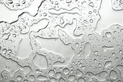 El agua sobre el vidrio Foto de archivo
