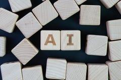 El AI, la inteligencia artificial o el aprendizaje de máquina en el concepto futuro del mundo, se rezagan los bloques de madera d fotografía de archivo