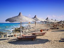 El alamein riviera. Umbrellas and sun loungers on the beach of El Alamein Stock Photography