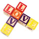 El alfabeto bloquea amor del deletreo en el estilo cruzado de Criss Imagen de archivo libre de regalías
