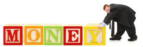 El alfabeto bloquea el DINERO Imagen de archivo libre de regalías