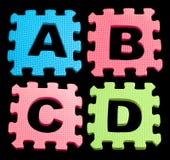 El alfabeto de ABCD que aprendía bloques aisló negro Fotografía de archivo