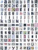 El alfabeto del periódico baja Imagen de archivo