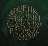 El alfabeto del vintage pone letras y numera a verde Fotografía de archivo