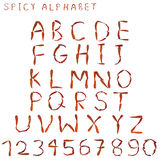 El alfabeto picante con la letra deletreó por la pimienta de chile picante tailandesa secada foto de archivo