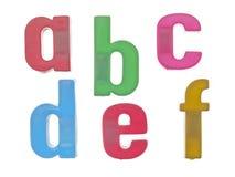El alfabeto plástico pone letras al abcdef Imagen de archivo libre de regalías