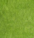 El algodón eriza el fondo verde de la toalla Foto de archivo libre de regalías
