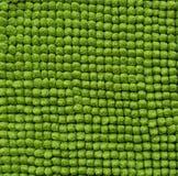 El algodón eriza el fondo verde de la toalla Fotos de archivo libres de regalías