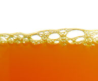 El amarillo burbujea zumo de naranja Fotografía de archivo libre de regalías