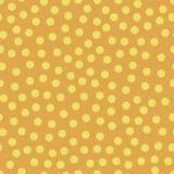 El amarillo inconsútil del vector de la repetición puntea en fondo anaranjado Randoml stock de ilustración
