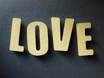 El amor de la palabra en el fondo de papel Imágenes de archivo libres de regalías