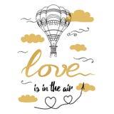 El amor dibujado mano positiva del lema está en el globo caliente adornado aire Fotografía de archivo libre de regalías