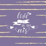 el amor está en las letras de aire Cita inspirada romántica Tipografía para el cartel del día de tarjetas del día de San Valentín Foto de archivo