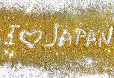 El amor Japón de la inscripción I en brillo de oro chispea en el fondo blanco imagen de archivo