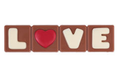 El amor y el corazón de la palabra para una barra de chocolate Imágenes de archivo libres de regalías