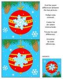 El Año Nuevo o la Navidad encuentra el rompecabezas de la imagen de las diferencias con la bola roja Imagen de archivo libre de regalías