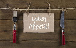 El apetito del Bon o disfruta de su comida en lengua alemana publicidad Fotos de archivo