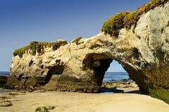 El arco en la playa de estado del campo del faro fotografía de archivo