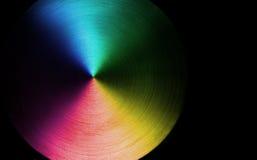 El arco iris colorea el disco Imagen de archivo