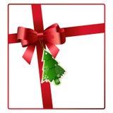 El arco y la cinta rojos con el árbol de navidad marcan vector con etiqueta Fotos de archivo libres de regalías