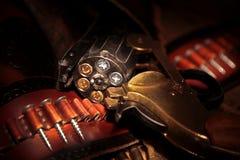 El arma con los tornillos fotografía de archivo libre de regalías