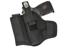 El arma en la pistolera Aislado foto de archivo