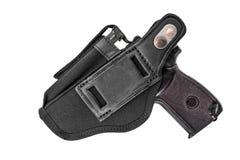 El arma en la pistolera Aislado foto de archivo libre de regalías
