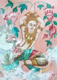 Pintura tailandesa del estilo del arte tradicional en la puerta en el templo, norte de Tailandia Foto de archivo libre de regalías