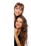 El asimiento de dos mujeres en sus manos limpia el cartel Imagen de archivo