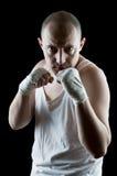 El atacar del boxeador Imagenes de archivo
