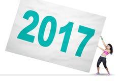 El atleta indio tira de los números 2017 a bordo Imagen de archivo libre de regalías