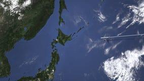 El avión comercial llega a Sapporo, Japón, animación 3D almacen de video