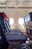 El avión sienta fila Imagenes de archivo