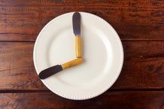 El ayuno es un método de la pérdida de peso cuya meta es hacer que el cuerpo utiliza las tiendas gordas foto de archivo