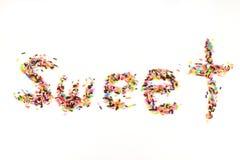 El azúcar asperja Imagenes de archivo