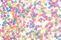 El azúcar asperja los corazones de los puntos, decoración para la torta y panadería, como fondo Imagenes de archivo