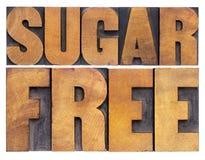 El azúcar libera en el tipo de madera foto de archivo libre de regalías