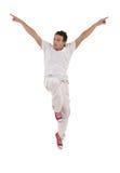 El bailarín con las manos para arriba salta Foto de archivo libre de regalías