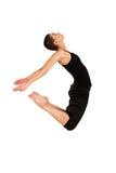 El bailarín que salta en blanco imagenes de archivo
