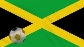 El balón el agitar y de fútbol de la bandera de Jamaica gira, lazo almacen de metraje de vídeo