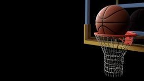 El baloncesto que entraba aro en negro aisló el fondo Diviértase a Foto de archivo libre de regalías