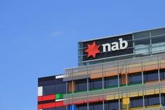 El banco nacional de Australia AGARRA el logotipo Imagen de archivo libre de regalías