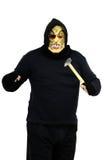 El bandido enmascarado amenaza con un martillo Fotos de archivo