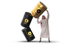 El barril de aceite favorable del hombre de negocios árabe Fotos de archivo libres de regalías