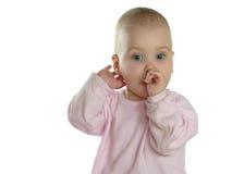 El bebé amamanta el dedo aislado Fotografía de archivo libre de regalías