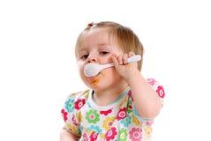El bebé come Fotos de archivo libres de regalías